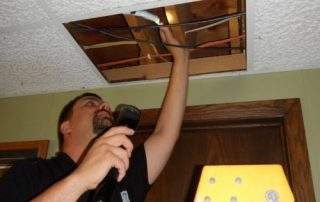 Are home inspectors required to move ceiling panels?